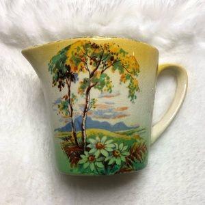 Vintage ceramic creamer cup made in England cracks